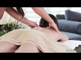 Hot chick is enjoying exciting massage from two lesbians