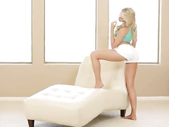Sweet and sexy blonde is hotly undressing to masturbate