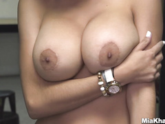 Wonderful young Muslim chick Mia Khalifa strips and poses nude