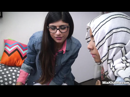 Adorable young Mia Khalifa is teaching the Arab chick how to deepthroat big dick