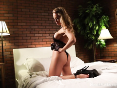 Beautiful porn model Nicole Aniston is having erotic photo session