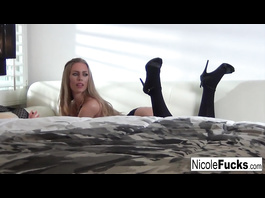 Exciting hot blonde Nicole Aniston sexily poses in black underwear