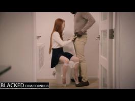 Ginger schoolgirl pleasantly fondles big black dick in the bathroom
