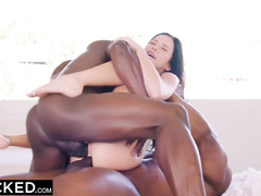 Petite brunette Megan Rain is sucking black cock and feeling second dick in her deep cunt
