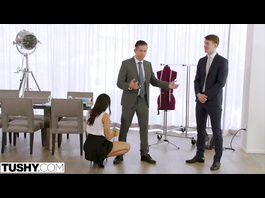 Brunette beauty wearing short skirt enjoys double penetration threesome in the office