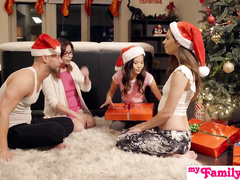 Slutty sisters are fucking their stepbrother by the Christmas tree
